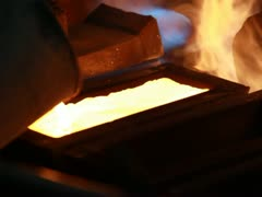 Molten Gold being poured into Ingot moulds - stock footage
