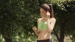 Sports, young woman with mp3 player listening to music and jogging Stock Footage