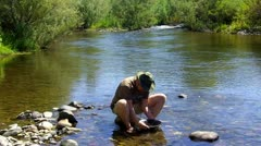 Man Panning For Gold Sierra Mountain Stream 2 Stock Footage