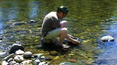 Man Panning For Gold Sierra Mountain Stream 1 Stock Footage