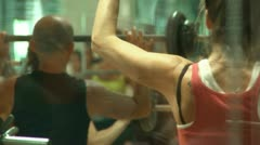 Exercising in the gym - stock footage