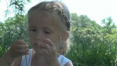 Child Playing with Grass in a Park Stock Footage