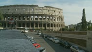 Coach drives by, Colosseum in background Stock Footage