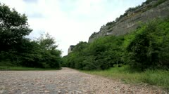 Movement of vehicles along a mountain road. Stock Footage