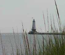 North Breakwater Lighthouse through grass - stock footage