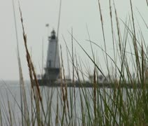 Ludington Lighthouse through grass - stock footage