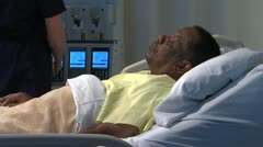 African american patient responds to nurse in hospital CU Stock Footage