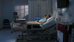 Male patient alone in hospital room - stock footage