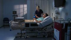 Male patient responds to nurse - stock footage
