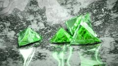Green trillion cut diamonds falling and rolling down Stock Footage