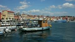 Fishing boats moored in the harbor at Rovinj Croatia Stock Footage