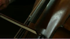 CU Cello being played bow across strings with audio - stock footage