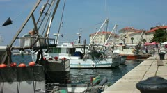 Fishing boats moored in the harbor at Porec Croatia Stock Footage