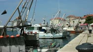 Stock Video Footage of Fishing boats moored in the harbor at Porec Croatia