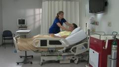 Nurse Lori attends to Patient Jim - stock footage
