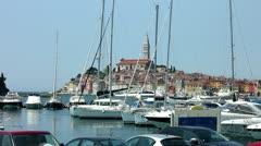 Boats moored in the harbor marina at Rovinj Croatia - stock footage