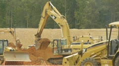 Construction Vehicles digging dirt Stock Footage