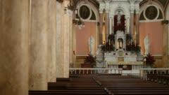 Interior catholic church rack focus pillar to altar Stock Footage