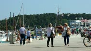 Stock Video Footage of People walking and cycling around the harbor at Rovinj Croatia