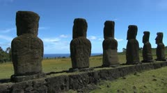 Easter Island Ahu Akivi backs and ocean between 3a Stock Footage