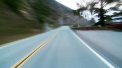 Coastal road rough speeding through landscape Stock Footage