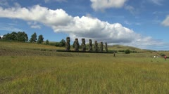 Easter Island Ahu Akivi moai row across grass zoom in 15b Stock Footage