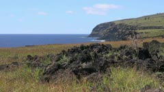 Easter Island east coast dark cliffs and volcanic rock 1 Stock Footage