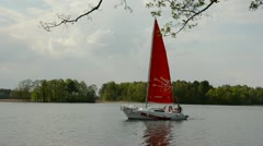 Yacht with red sail on the lake Stock Footage
