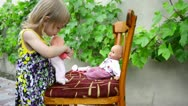 A little girl plays with dolls Stock Footage