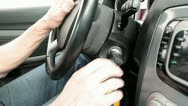 Men's hand turns the ignition key in the car Stock Footage