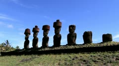 Anakena Beach moai in a row below a  blue sky Stock Footage