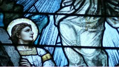 Stained glass tilt up from mary to jesus Stock Footage