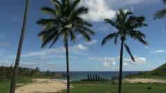 Easter Island Anakena Ahu Nau Nau moai sand and palms 1 Stock Footage