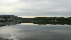 Arisaig waterfront reflected Scotland Stock Footage