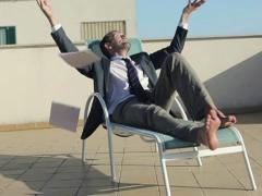 Happy businessman throwing away paperwork, slow motion, dolly shot NTSC Stock Footage