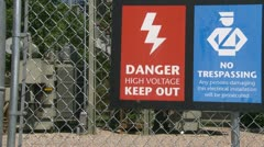 "Electric substation sign ""Danger High voltage Keep out"" Stock Footage"