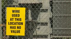 "Electrical substation, sign ""wire has no value"" Stock Footage"