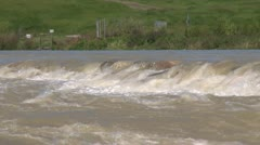 Bow River high stream flow advisory, near flooding water at weir - stock footage