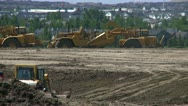 Stock Video Footage of construction site, earth-movers and bulldozer long lens