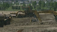 Stock Video Footage of construction site, excavator and graders long lens