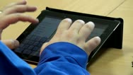 Worker is printing on a Tablet PC Stock Footage