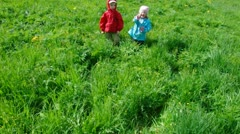 Boy and small girl  on meadow Stock Footage