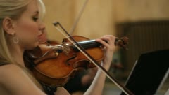 Young woman playing violin MS Stock Footage
