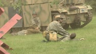 Stock Video Footage of Army medic treats wounded soldier