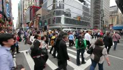 Crowd of people walking crossing street at intersection in New York City Stock Footage