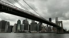 Dark clouds moving in over New York City downtown Brooklyn Bridge Stock Footage