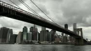 Stock Video Footage of Dark clouds moving in over New York City downtown Brooklyn Bridge