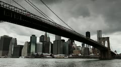 Dark clouds moving in over New York City Brooklyn Bridge timelapse 25P PAL Stock Footage
