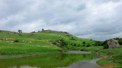 Mountain river in the background of green hills Stock Footage