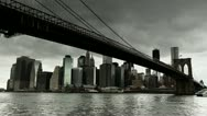 Stock Video Footage of Dark clouds hanging over New York City Brooklyn Bridge timelapse 25P PAL